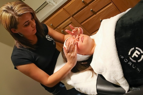 Student and model performing a facial at The Forum Academy