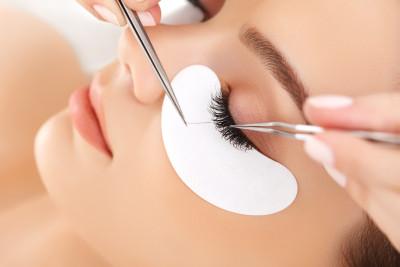 Female Eye with Long Eyelashes getting Eyelash Extensions.